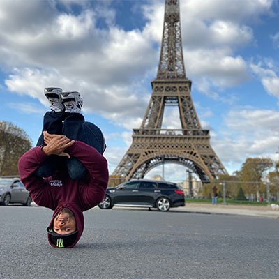 head stand eiffel tower